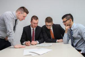 Group of men assessing a deal